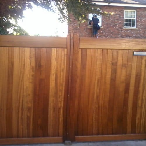 Hardwood Iroko gates with a flat top for the driveway – front
