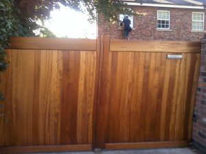 Flat Top wooden driveway gate installation made from Iroko