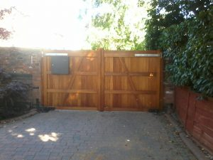 Flat top Wooden Driveway Gate Installation made from Iroko automatic opener