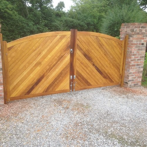 Bow top double Iroko gates, herringbone boarding oiled