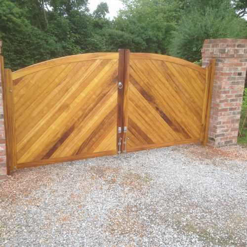 Bow Top Double Driveway Gates made from Iroko. Double sided with herringbone(diagonal) boarding
