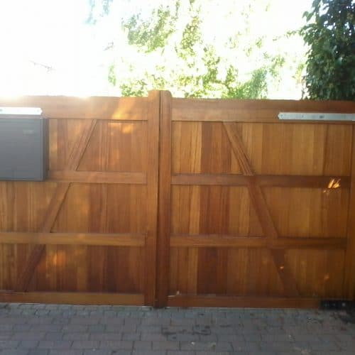 Hardwood Iroko gates with a flat top for the driveway – back